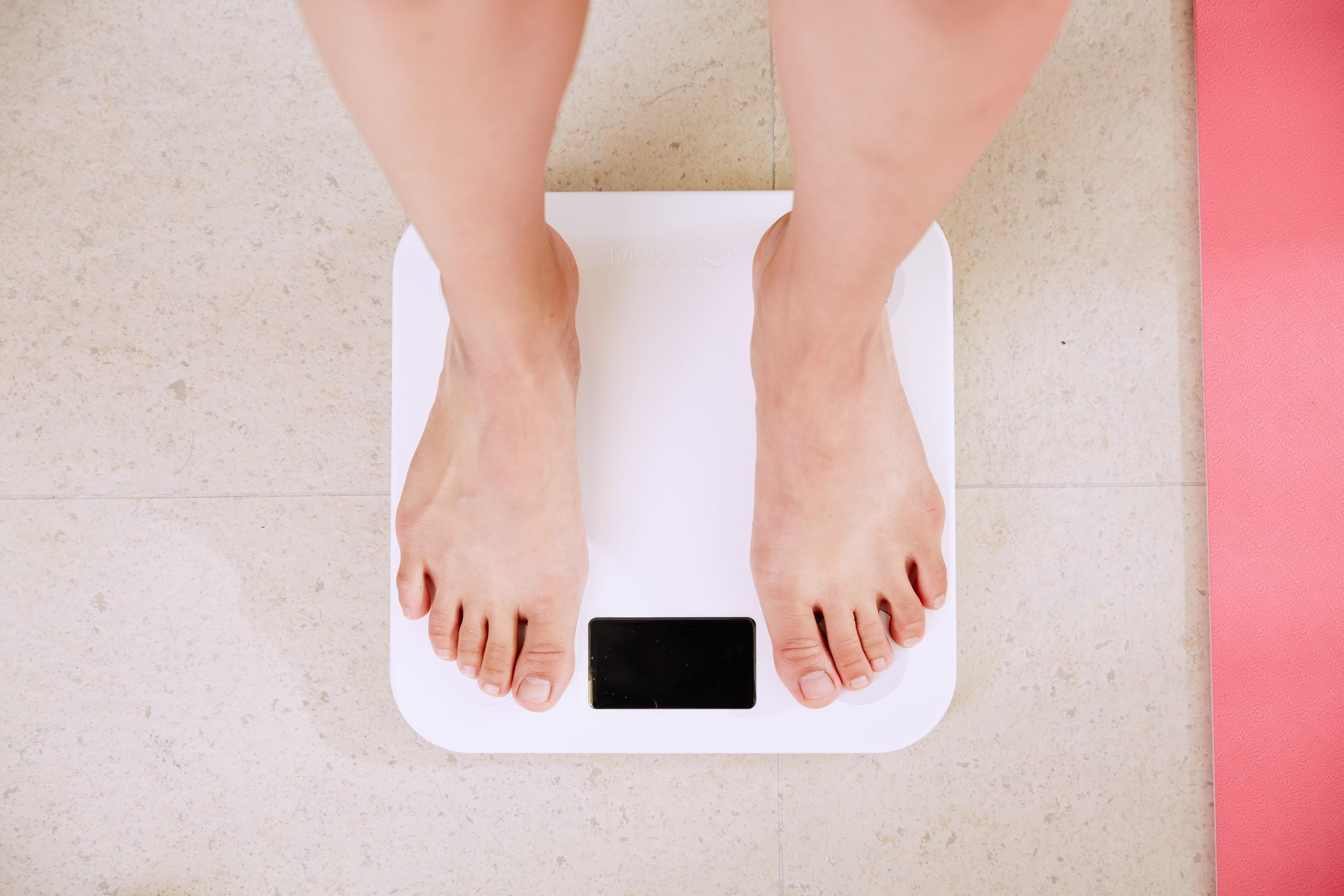 person standing on digital scale