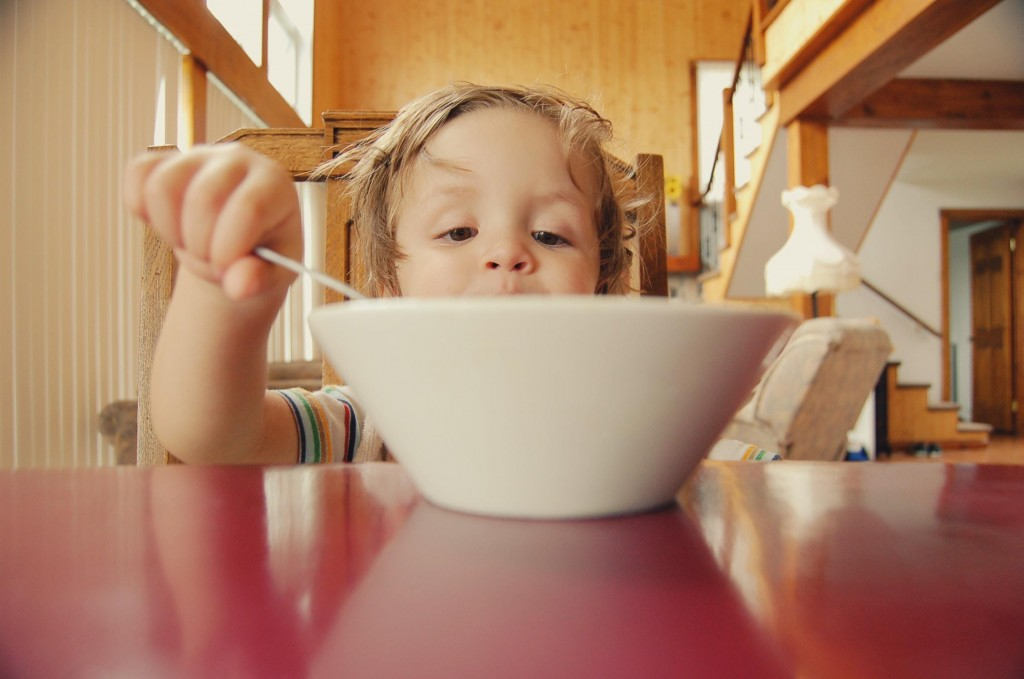 child eating food from the bowl