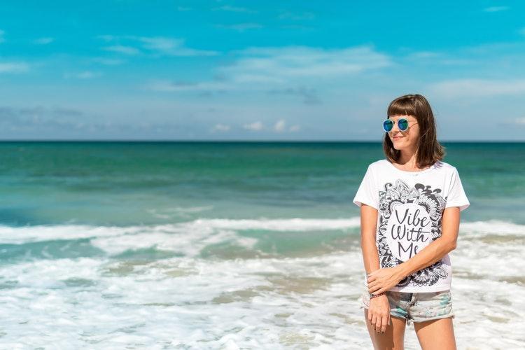woman in white crew neck Shirt near sea shore
