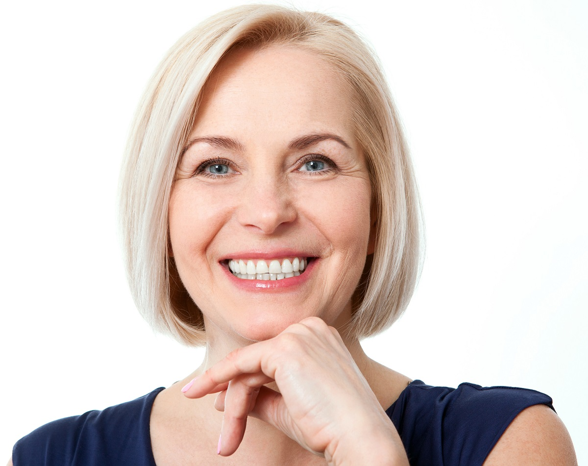 happy aged woman over white background