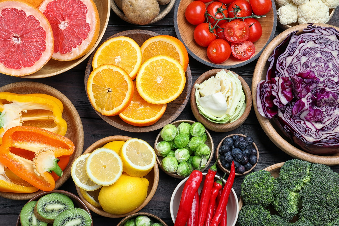Different products rich in vitamin C on wooden table