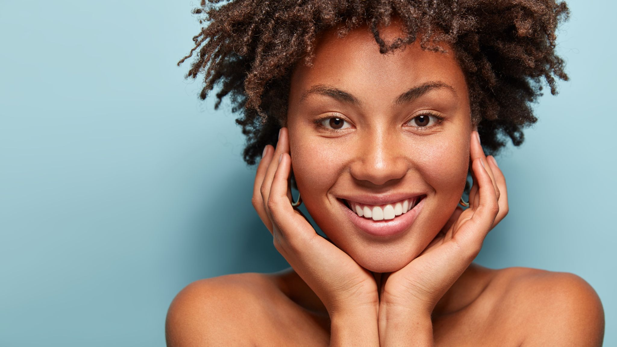 relaxed black woman has gentle skin after taking shower